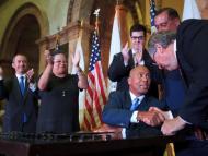 House Speaker Robert DeLeo Congratulates Governor Deval Patrick Upon Siging Payment Reform Law
